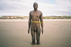 Things that happen to Gormleys (knautia) Tags: uk england sculpture film beach seaside october fuji superia olympus ishootfilm xa2 200iso publicart tied olympusxa2 bound crosby antonygormley merseyside 2015 anotherplace crosbybeach nwweek2015 xa2roll169