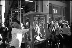 The All-Seeing Trump (OQ62) Tags: leicam6 ttl leica m6 film analog blackandwhite 35mm newyorkcity nyc trump donaldtrump gothamist kodak tmax 400 kodaktmax400 theallseeingtrump the all seeing fortune telling zohar