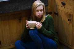 Cold days (Tinekedw) Tags: wood winter portrait cold green cup kitchen coffee girl sadness wooden sweater warm alone sad floor serious drink warmth ground indoors blond blonde inside