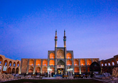 a wooden nakhl in front of the three-storey takieh which forms part of the amir chakhmaq complex, Yazd Province, Yazd, Iran (Eric Lafforgue) Tags: city travel people urban building tower art horizontal architecture night religious outdoors town persian twilight worship iran symbol minaret islam traditional religion scenic middleeast culture persia bluesky landmark mosque illuminated amir shia muharram ashura iranian bluehour copyspace tradition complex hossein hussein cultural attraction imam yazd shiite zoroastrian persiangulfstates nakhl smallgroupofpeople  fulllenght  tazieh colourimage  iro shiism chaqmaq  yazdprovince takieh amirchakhmaqcomplex westernasia chakhmagh hosseinieh  takyeh 16976 hoosieneh hossieneh takiek