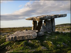 Poulnabrone Dolmen - Color (Firery Broome) Tags: blue ireland sky brown sun green field grass clouds photoshop landscape rocks stones historic 365 cairn sunsetting bronzeage apps neolithic chambertomb countyclare poulnabrone historicplaces alienskin irishlandscape poulnabronedolmen viveza 570uz olympus570 historicireland historicicons irishhistoric