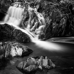 Finding its way (Ginger Snaps Photography) Tags: water waterfall rock rockface strathconnon sigma nisi filter 10stop ndfilter contrast mono monochrome bw blackandwhite canon highland scotland river smooth flow