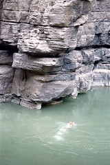 34-403 (ndpa / s. lundeen, archivist) Tags: nick dewolf nickdewolf color photographbynickdewolf 1970s 1973 film 35mm 34 reel34 arizona northernarizona southwesternunitedstates grandcanyon coloradoriver raftingtrip raftingexpedition river water diver diving canyonwall canyonwalls rock rocks rocky cliff cliffs cliffdiver cliffdiving swimmer swimming 1972