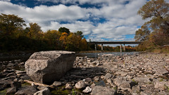 An Immovable Object (anthony_wan) Tags: rock boulder stream river rideau fall autumn sky highway bridge rocks ottawa ontario canada outdoor hogsbackpark nikon d5200 tokinaaf1120mmf28 stone
