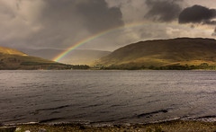 Over the Loch. (Ian Emerson) Tags: rainbow loch scotland mountains water sunny raining weather landscape clouds outdoor canon 1018mm wideangle omot