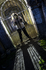 Caged offspring (Waving lights in the dark) Tags: treason gunpowder plot mask guy fawkes guyfawkes backlit backlight ledlenser offspring son caged bars prison shot x21r2 fountainsabbey fountains northyorkshire ripon