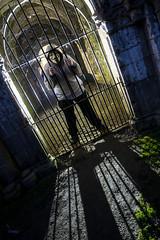 Caged offspring (Waving lights in the dark) Tags: treason gunpowder plot mask guy fawkes guyfawkes backlit backlight ledlenser offspring son caged bars prison shot x21r2 fountainsabbey fountains northyorkshire ripon
