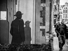 Hide and seek (SibretManu) Tags: streetphotography portrait street black white bw candid going moments decisive moment creative commons flickr flickriver explore eyed eye scene strassenfotografie fotografie city square squareformat photography