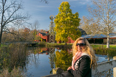 Look what the wind blew in... (tquist24) Tags: bonneyvillemillcountypark indiana nikon nikond5300 outdoor wanda autumn fall geotagged girl park portrait reflection reflections river scarf smile sunglasses tree trees water windmill woman