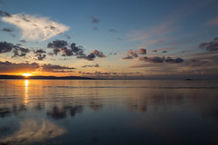 The Sun Slowly Slips Away (cathbooton) Tags: weather nature silhouettes hills sun merseyside wirral canonusers canon6d canoneos coast beach reflection water sunset november clouds sky