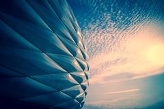 Allianz Arena Munchen (Sandra Kche) Tags: trip blue sunset pordosol colors azul architecture clouds germany munich bayern deutschland football europe naturallight arena nuvens munchen viagens estdio futebol goldenhour alemanha munique soucer