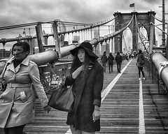 walking the bridge (rosserx) Tags: bridge people blackandwhite ny newyork girl hat brooklyn clouds coat top20bridges