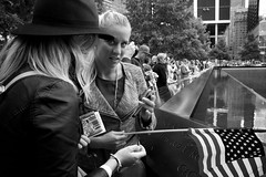 (heatherbirdtx) Tags: street city blackandwhite usa newyork america women memorial phone map availablelight candid flag 911 strangers tourists groundzero
