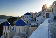 Magical sunset moments in Oia (Gregor  Samsa) Tags: blue houses roof light sunset sky sun house church island greek islands town spring village aegean may illumination churches roofs greece dome domes greekislands orthodox oia cyclades settlement clifftop bluedomes οία lessercyclades