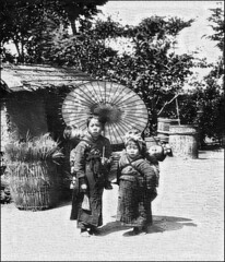 Processed Recursive Baby Sitting in Japan (sjrankin) Tags: japan umbrella children japanese edited historic grayscale handcolored babysitter processed filtered 9october2015