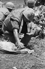 BE020700 (thanhtan327) Tags: people men dead soldier holding marine war asia southeastasia military helmet vietnam violence bible americans males leader whites adults scripture touching clergy headgear religiousleader southvietnam 1andgroup militarypersonnel historicevent northamericanhistoricalevent unitedstateshistoricalevent vietnamwar19591975 quangtriprovince conthien northcentralcoastregion