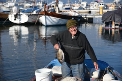 happy old fisherman (Tomislav Bicanic) Tags: old sea italy fish reflection smile happy boat fisherman sardinia catch santantioco calasetta world100f