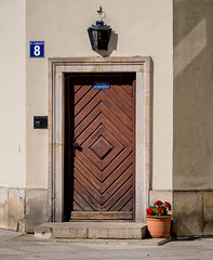 Wooden door with flower pot, Warsaw (RWYoung Images) Tags: street door travel urban holiday flower sign wall corner poland olympus warsaw em5 quantumentanglement rwyoung