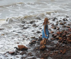 Lady in a blue dress, on the rocky shore (rodeochiangmai) Tags: water ladies cambodia rocks bluedress