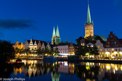 German Skyline (breakfast_pizzas) Tags: german skyline germanskyline germany lubeck lubeckgermany church churches catholic catholicchurch catholicchurches river reflections night sunset dusk lights clouds medieval northern northerngermany nightphotography nightsky nightlife canonnightphotography light streetlights street riverreflections water waterreflections gothic medievalchurch europe outside boat riverboat boats riverboats tree trees canon canon60d canonphotography sun set stars