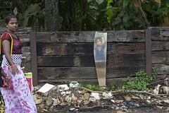 Visions (Photosightfaces) Tags: vision visions reflected sri lankan lanka lady woman srilankansri walking passing mirror image rubbish fence