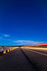 Big Dipper ([ raymond ]) Tags: img5754 night bigdipper stars longexposure newmexico southwest highway road trails car ursamajor sky blue horizon