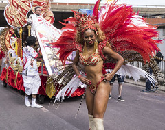 notting hill girl in the red feathers (Mark Rigler UK) Tags: portrait beautiful school samba notting hill carnival 2016 london england party street girl dance festival carribean parade music bass candid people brazilian costume ladbroke grove westbourne