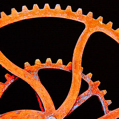 Dance of the Gears (studioferullo) Tags: abstract art beauty blackbackground bright cog colorful orange gold red rust contrast curve curves design detail gear gears geometry light machinery metal pattern pretty study texture tone tones scottsdale arizona