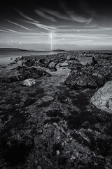 Working with the wind (miguel_lorente) Tags: blacknwhite longexposure oosterscheldekering netherlands blackandwhite rocks seascape water windmill bw filter bnw holland nd zeeland