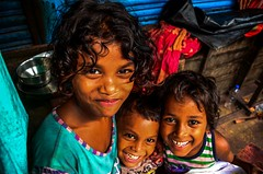 smiles - comes so easy for these street kids (s) Tags: india smile kids joy nikkor playful kolkata streetkids kalighat desertedstreets cityofjoy 18105mm nikond7000 kalighattemplearea bandhstrike