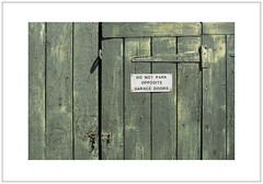DO NOT PARK OPPOSITE GARAGE DOORS (Pictures from the Ghost Garden) Tags: light urban signs nikon doors shadows 28mm oxford oxfordshire voigtlnder urbanlandscape colorskopar d7100