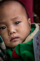 Mother's Arms (paulpaulpauly) Tags: boy baby village arms mother tribe laos ethnic minority luangnamtha