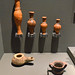 Greek ceramic unguentaria, lamp, and miniature vessel from Volimos