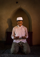 iranian shiite muslim student praying in a madrassah, Golestan Province, Karim Ishan, Iran (Eric Lafforgue) Tags: boy portrait people house male men vertical architecture religious student ancient worship iran madrasah muslim islam traditional faith bricks religion praying middleeast belief cap shia orient kneeling madrassa pupil prayers oneperson islamic shiite placeofworship caravansaray madrassah caravanserai turkmen gorgan golestanprovince youngadultman 1315years persiangulfstates   16364 oneboyonly colourimage 1people  iro torkaman shiism knelling  westernasia  gomishan oneteenageronly karimishan