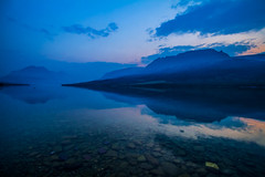 Still Silent (West Leigh) Tags: blue sunset lake mountains reflection nature landscape climb montana rocks dream peaceful roadtrip hike glacier wanderlust explore reflect experience serene naturalbeauty nationalparks wander contemplation discover marylake canoneos7d