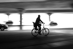 The race (Birdhouse camper) Tags: copenhagen denmark iphone iphone6s street silhouette panning blackandwhite blackwhite bicycle