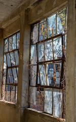 ex_DSC7645 (DianeBerky19) Tags: nikondf ellisisland rust texture peelingpaint chippingpaint brokenwindow