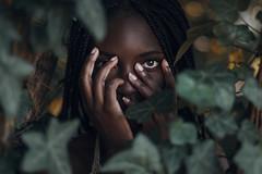 Overawed (Enrico Cavallarin) Tags: leaves leaf woods nature wild native darkskin africa blackgirl girl hands hidden intothenature intothewild intotheforest intothewoods fear scared afraid 50mm portrait portraiture