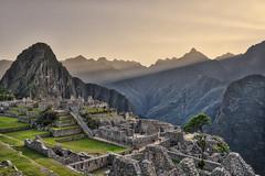Sunrise at Machu Picchu (Matt S Dawson) Tags: machu picchu peru sunrise mountain ruins rocks sky colour grass sunrays rays sun light south america latin