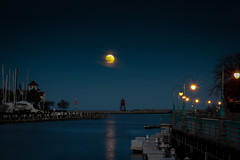 Super Moon down the River (mraarondouglas) Tags: super moon night nighttime root river water lake michigan lights street stars sunset sun sunsetting clouds cloudy colors colorful color long exposure racine wi wisconsin chicago milwaukee photography photo photograph image canon canon1585 rebel t5 1200d brige drawbridge road main lighthouse rocks harbor marina