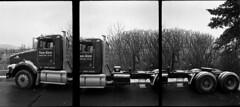 tryptic truck (Paul Lundberg) Tags: canondemis17 kodaktrix400 kodakhc110 film blackwhite plustekopticfilm7300 semitruck