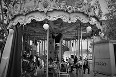 Setting the carousel (nene92) Tags: carousel giostra horses cavalli monocromo woman street padova italy