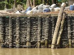 IMG_3334 (program monkey) Tags: vietnam mekong river delta cargo boat ben tre tra vinh palm tree weave wall trash garbage