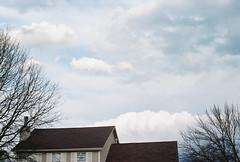 Spent about an hour sitting in the bottom of my shower (nerve jamming) Tags: house sky clouds dusk blue white fluffy film analog nikkormat ft vintagenikon nikon nikonfilm kodakfilm kodakcolor colorfilm density contrast angle thunderhead