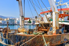 Trawler, Crete (jack cousin) Tags: sea building water port buildings harbor boat nikon rust waterfront harbour hill rusty bluesky rope mooring hull fishingboat stern winch trawler moored d610 ayiosnikolaos on1photos