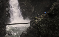 These guys are crazy (1withone) Tags: mountain rock danger waterfall stream falls dyke photoart risky cascadefalls