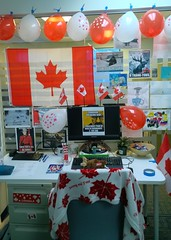 Celebrating a colleague's Canadian residency (Ruth and Dave) Tags: decorations red white balloons office desk flags canadian posters mapleleaf memes decorated