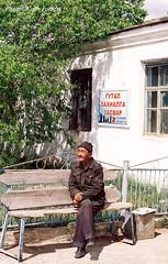 Kharkhorin Market/17 (Cath Forrest) Tags: man tree bench market text mongolia mongolians kharkhorin orkhonvalley kharkhorinmarket