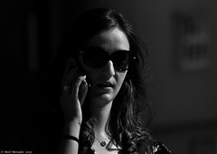 Street Chic. (Neil. Moralee) Tags: street shadow portrait blackandwhite bw woman white black portugal girl beauty face sunglasses lady female dark mono glasses nikon call phone close candid talk neil shades class ring porto su chic classy brith schick sheek d7100 moralee shheek