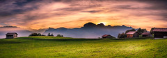 Sunset Panorama (marco soraperra) Tags: nikon nikkor sky color colorful landscape skyline mountains spring sun sunlight sunset light shadow mood green red grass hat panorama